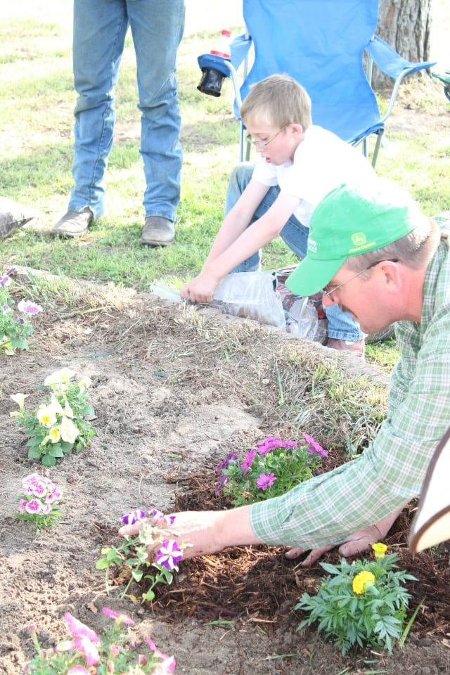 tony and emmet planting flowers1 Gardening with the Family
