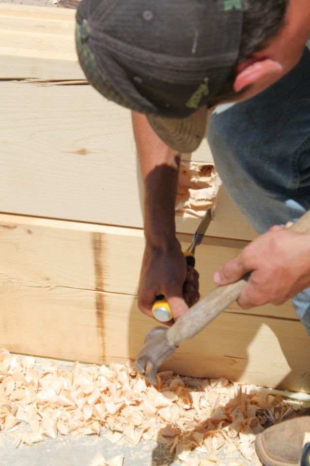Chiseling out the electric box for log cabin  missinthekitchen #LogCabinSaturday