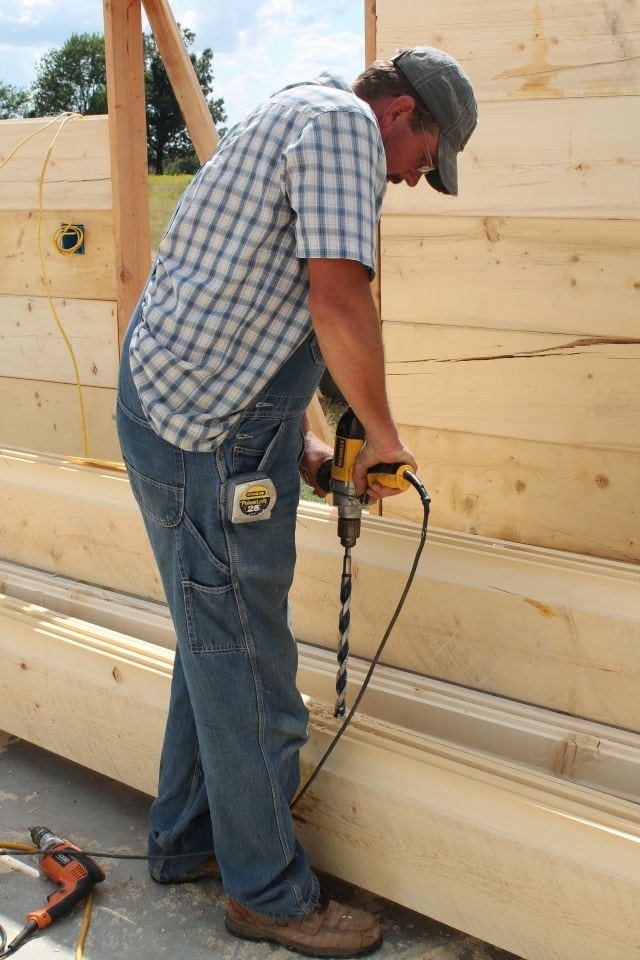 Drilling the holes for electric wires Log Cabin Saturday #2 Miss in the Kitchen