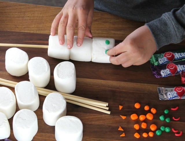 Adding the Eyes to the Airheads Marshmallow Snowmen ~ Miss in the Kitchen