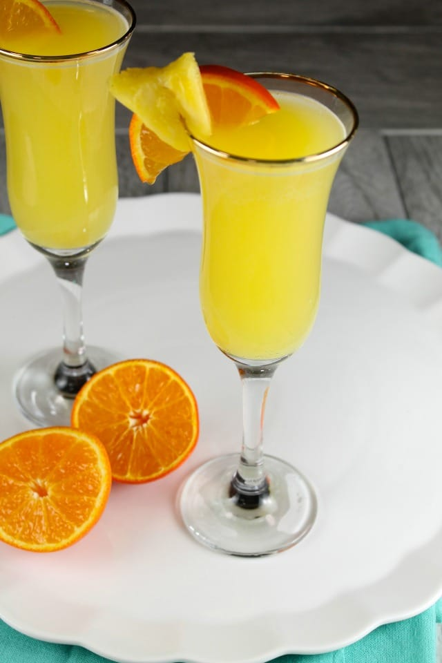 Pineapple Mimosa Cocktail Recipe ~ perfect for brunch! From MissintheKitchen.com