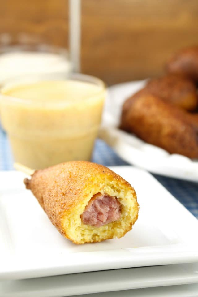 Homemade Mini Corn Dogs are a tasty bite- sized snack for family get togethers and game day parties. Made with a homemade cornbread batter and mini smoked sausages. Also try them for lunch or as an after school snack! Find the Recipe at Miss in the Kitchen