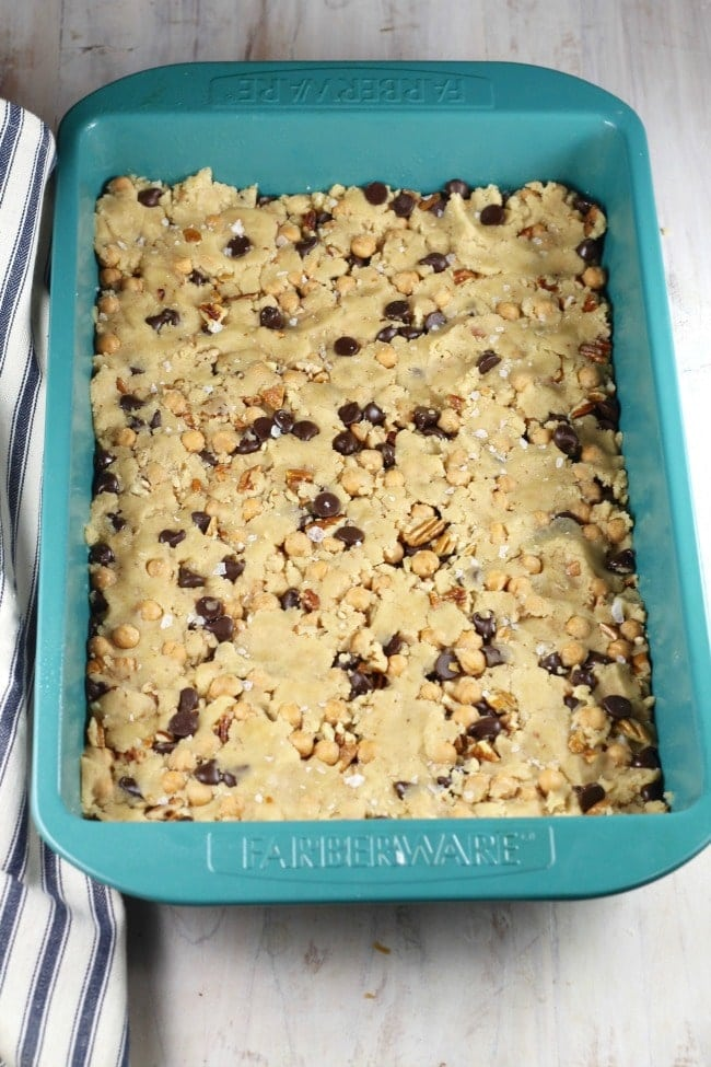 salted caramel cookie bars dough pressed into 9 x 13 pan