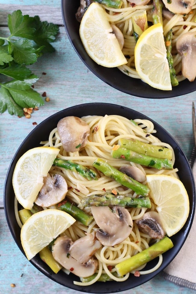 Lemon Parsley Angel Hair with Asparagus and Mushrooms garnished with fresh lemons