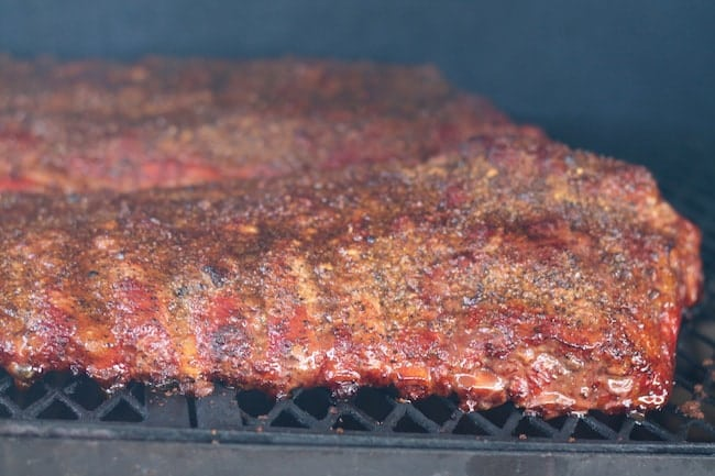 Smoked Spare Ribs with Brown Sugar and Garlic on the grill