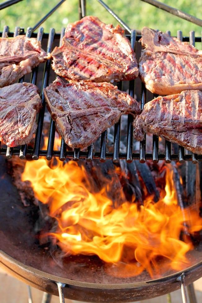 T-Bone Steaks over wood fire grill