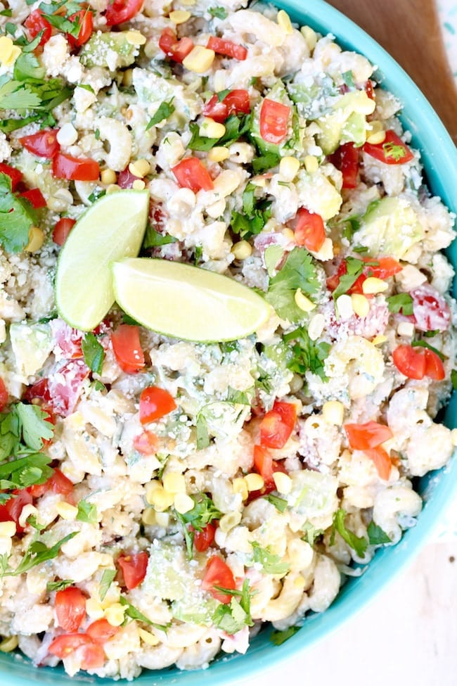 Mexican Street Corn Pasta Salad with lime, cilantro, corn, tomatoes and avocados