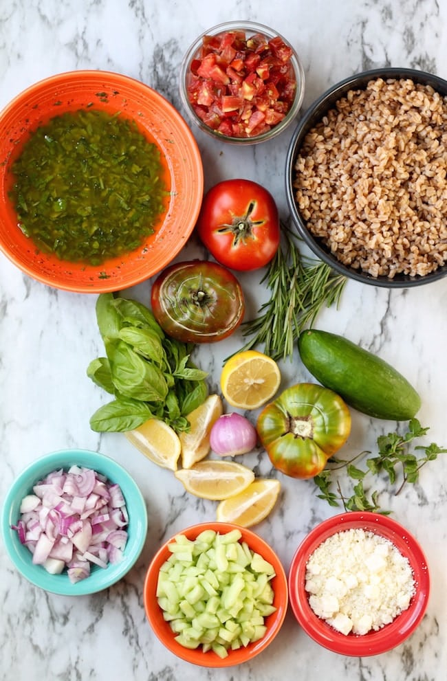 Fresh heirloom tomatoes, cucumbers, red onion, lemons, basil, rosemary, mint and farro