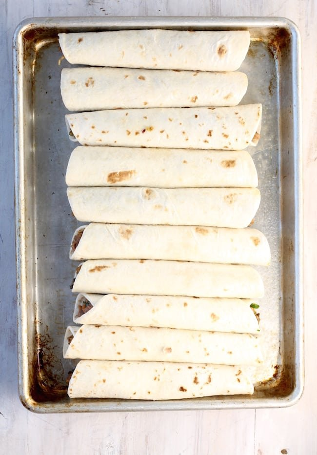 Pan of Brisket Taquitos ready for the oven