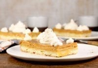Pumpkin Pie Bars topped with whipped cream