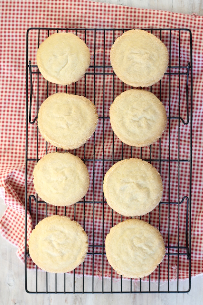 Wire cooling rack with the Best Ever Sugar Cookies and a gingham napkin