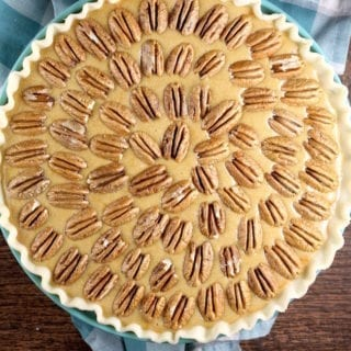 Pumpkin Pecan Pie with Whole Pecans ready for the oven