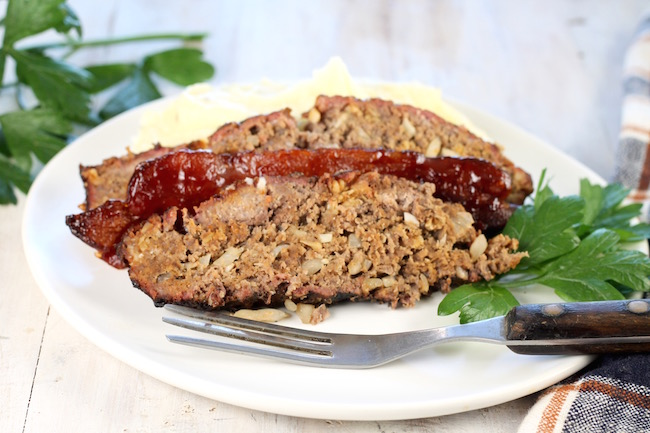 Sliced Smoked Meatloaf with bacon and mashed potatoes