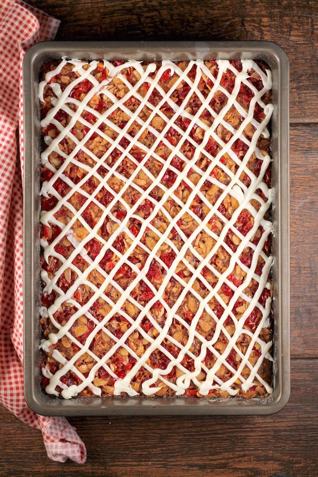 Cherry Almond Bars with Criss Cross Cream Cheese Icing