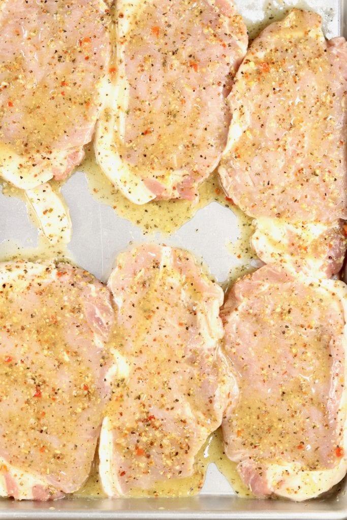 Boneless pork chops coated in zesty Italian dressing