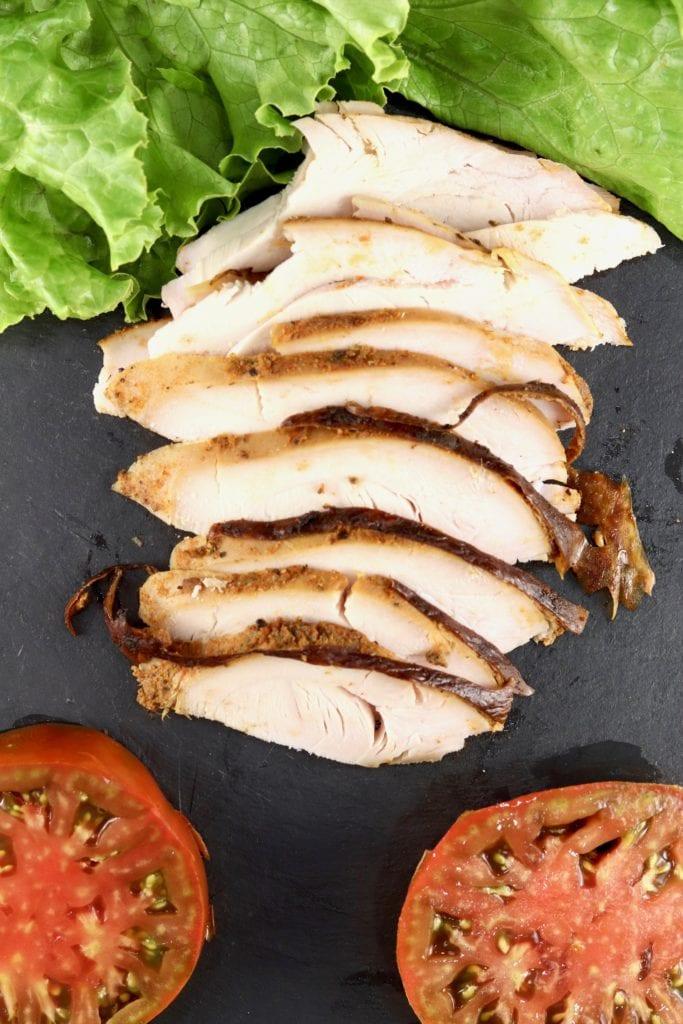Lettuce, sliced turkey breast and sliced heirloom tomatoes