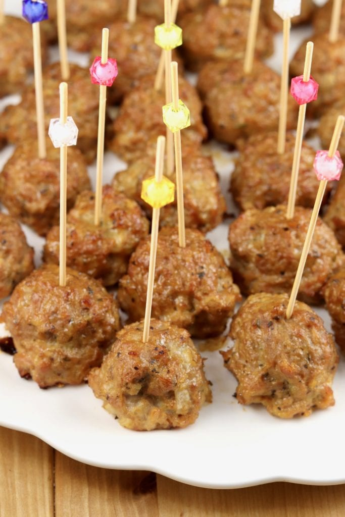 Meatball appetizers on a platter with party picks